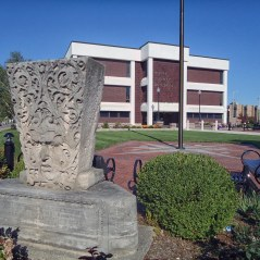 The southeast corner of the courthouse square is home to the cornerstone of the 1894 courthouse, as well as a carving from the building's exterior.