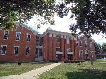 The 1873 Scott County Courthouse is used as the west (right) wing of the new courthouse, constructed in 1997.