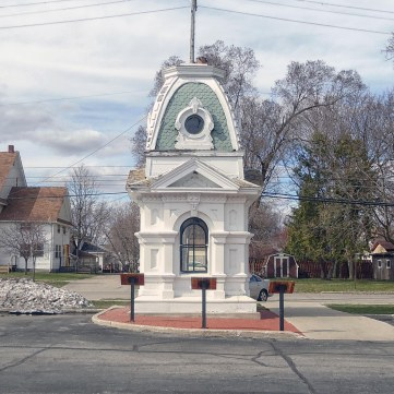 The cupola of the former Isabella County, Michigan courthouse outside its modern replacement.